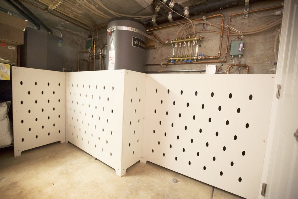 Water heater & pipe screens were designed by us; now the basement is safe for the young ones and more pleasing to the eye!