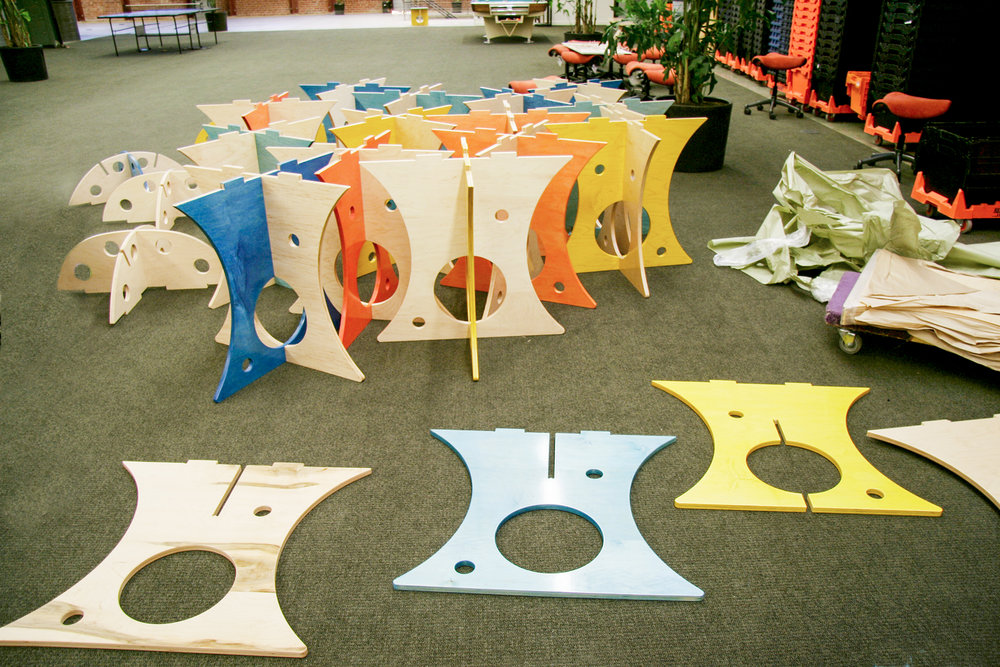 The colors of the legs in all of these tables comes through into the top, showing the construction and adding a delightful splash of color.