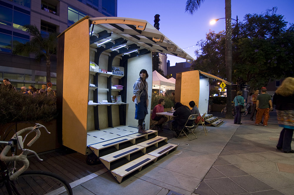 To be used during the First Fridays Art Walk in downtown San Jose, CA, these rolling, fold out art galleries were designed to be configurable into varrious positions, and be able to display a variety of different kinds of art.