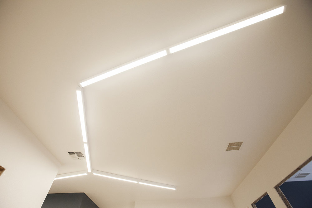 Since we wanted to change the lights out anyway, it was a good opportunity to do something fun and interesting. The space is small, and we wanted to keep the design clean and open feeling. This nice design on the ceiling is functional and adds a bit of interest when you first enter the space.
