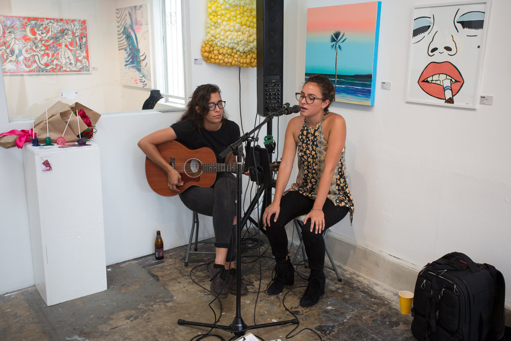 Erin performing at local art space, Shockboxx , with friend Regan Wojick for a 1736 Family Crisis Center charity event.