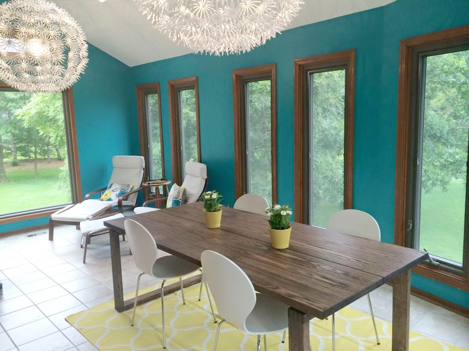Bold Colors - Add a bold color to one wall or an entire room for added warmth. I added this teal paint to our sunroom and used the same color as an accent throughout the house. We don't have l a lot of wall space in this room to add art pieces or accent pieces so it needed the color for some fun. Love it!