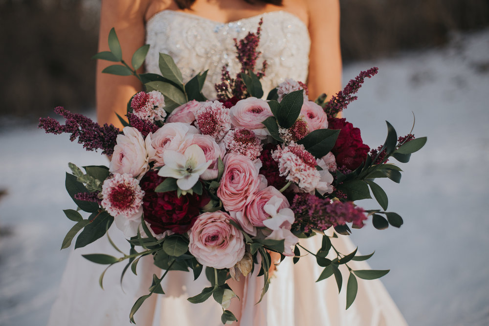 Organic Garden Bouquet  Style: Romantic, Wispy Details: Clooney ranunculus, hellebore, scabiosa, burgundy peonies, heather, ruscus, salal,   {Photo courtesy of  Morgan Barrett }