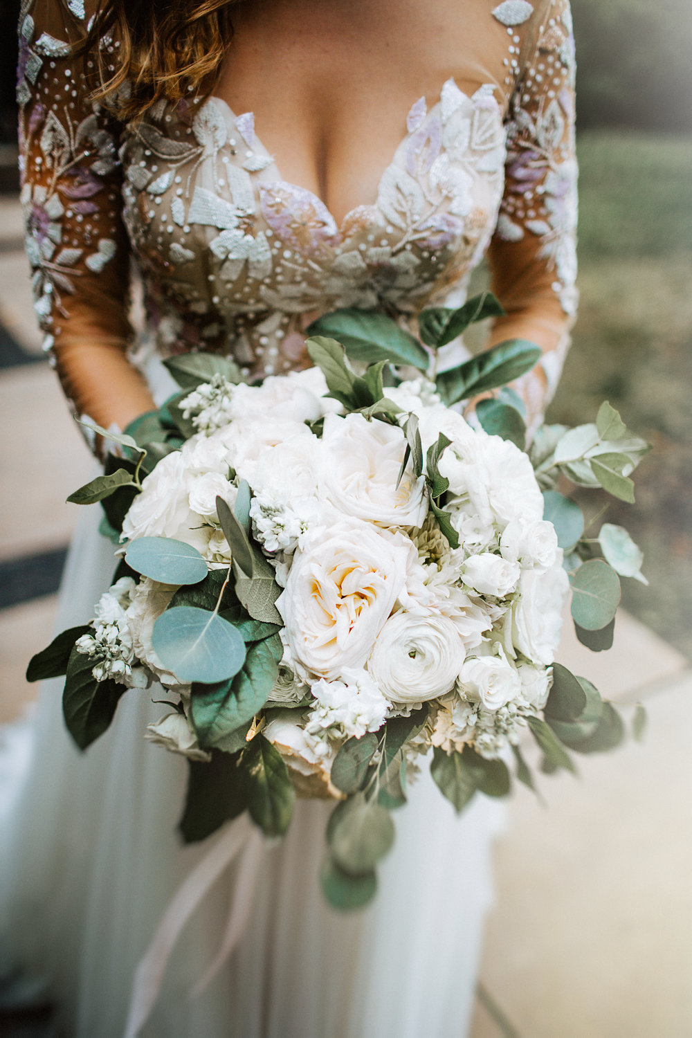 Loose Round Garden Bouquet  Style: Romantic Details: White Ohara Garden roses, ranunculus, stock, mixed greenery   {Photo courtesy of  Atley + Liz Collective }