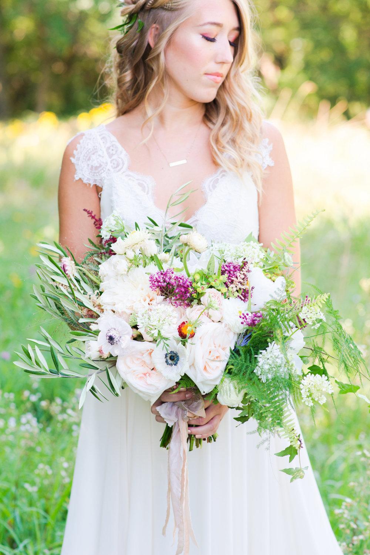 Wispy Garden Bouquet  Style: wispy, organic Details: Anemones, olive, fern, garden roses, straw flower   {Photo courtesy of  Lacey Rene Studios }