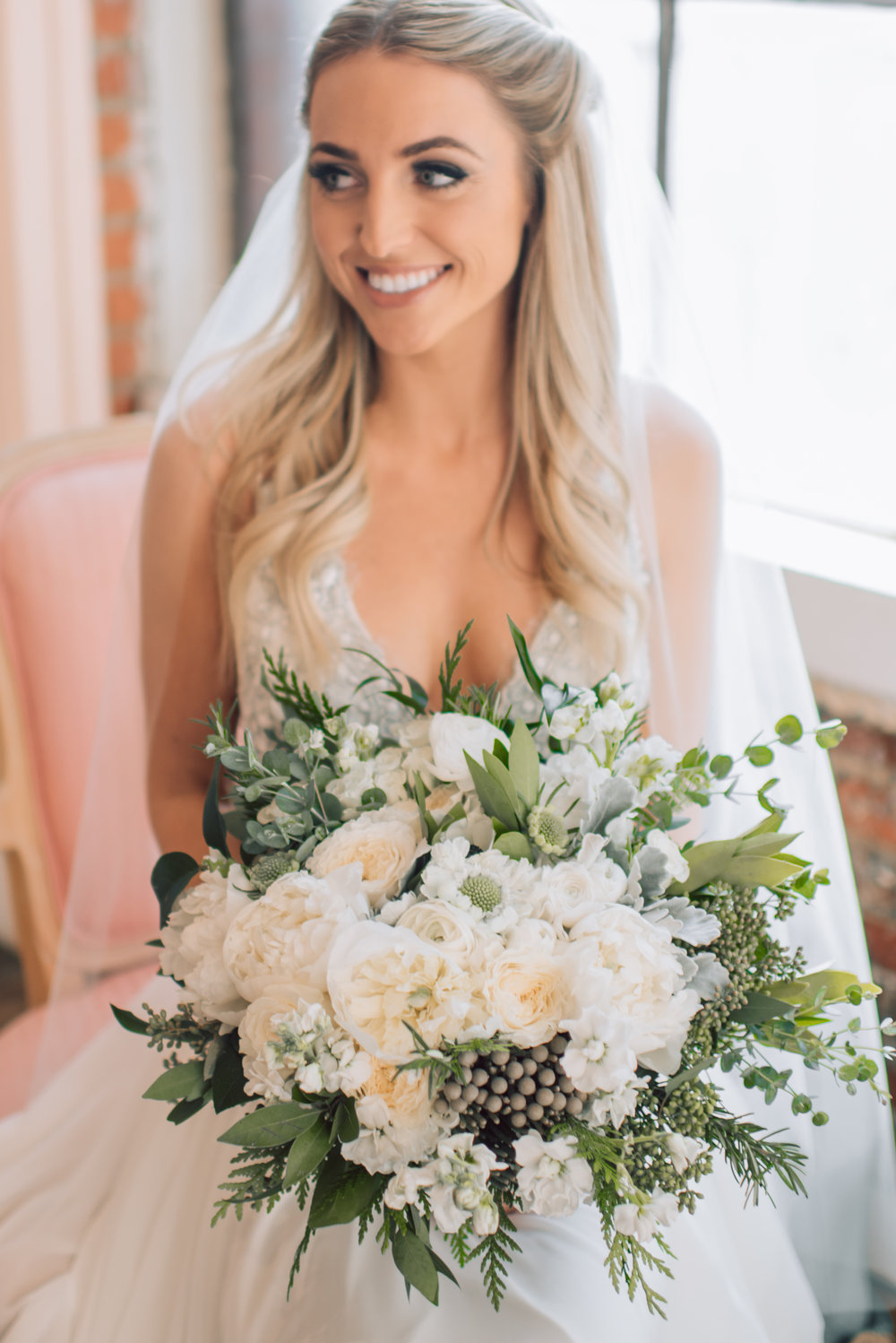 Large Textured Garden Bouquet  Style: Textured greenery, romantic Details: peonies, garden roses, scabiosa, brunia berries, gunni eucalyptus, bay leaf, seeded euc, ranunculus, winter greenery   {Photo courtesy of  Sara Rieth Photography }