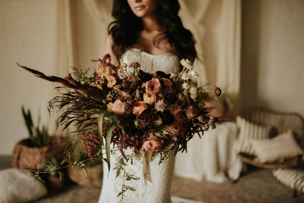 Large Oblong Organic Bouquet  Style: boho Details: ranunculus, straw flower, scabiosa, jasmine, blushing bride, protea, agonis, LOTS of texture   {Photo courtesy of  Hana Alsoudi Photography }