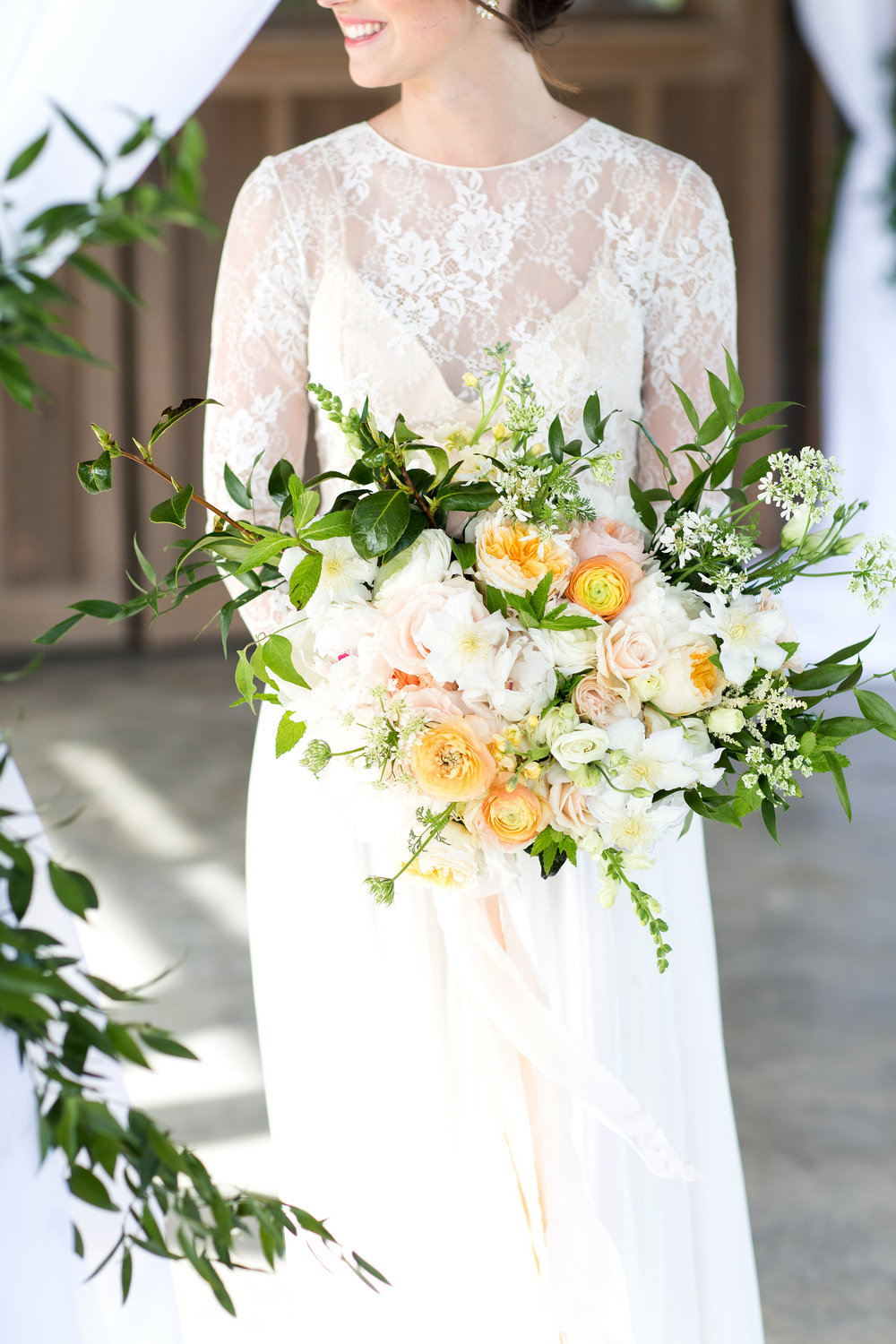 Wispy Garden Bouquet  Style: rustic, wispy, organic Details: ranunculus, lisianthus, stock, clematis, peonies, Juliet garden roses, full greenery   {Photo courtesy of  Melissa and Beth }