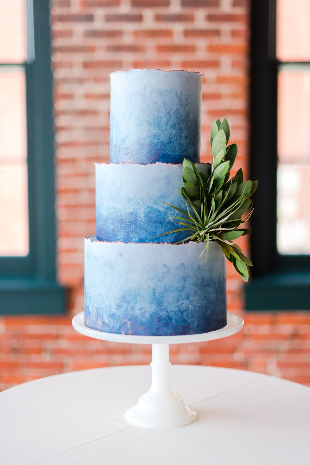 Blue Thistle Cakes - This jaw-dropping cake is just the tip of the iceberg on what owner, Heather, can create. Let me tell ya, I've had my fair share of wedding cake but nothing compares to the deliciousness of Blue Thistle.