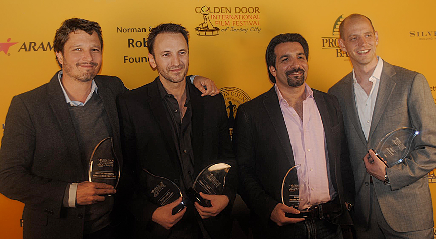 Dominik Tiefenthaler (Best Supporting Actor), Michael Wolfe (Best Lead Actor, Best Screenplay, Best Director), Robert Nicotra (Producer, Best Feature Film), and Mark Montgomery (Producer, Best Feature Film) at the 2012 Golden Door International Film Festival in Jersey City.