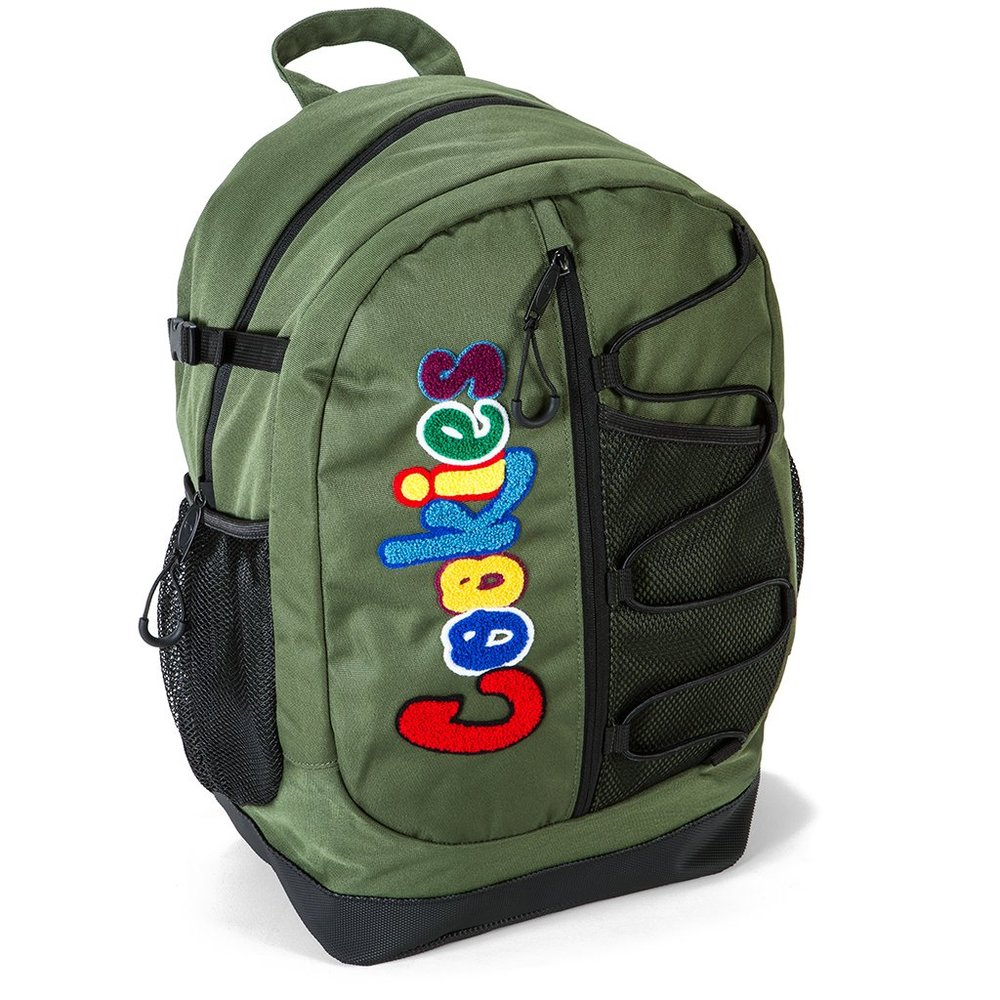 """BUNGEE BACKPACK - ° CHENILLE PATCH° POLYESTER° BUNGEE DETAILING° SMELL-PROOF° DOUBLE ZIPPER° """"U"""" BUNGEE PULLS° MESH POCKETS° PADDED BALLISTIC BOTTOM"""