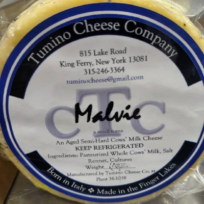 A wheel of Tumino's Malvie cheese, a type of toma cheese.