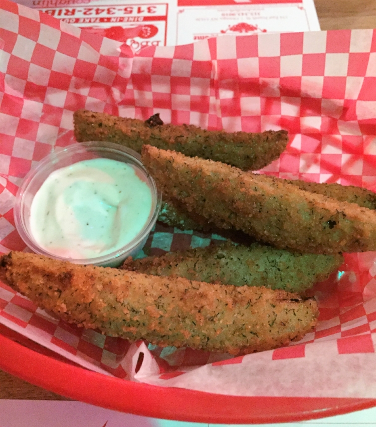 These fried pickle spears held all their breading despite repeated dips in ranch dressing.