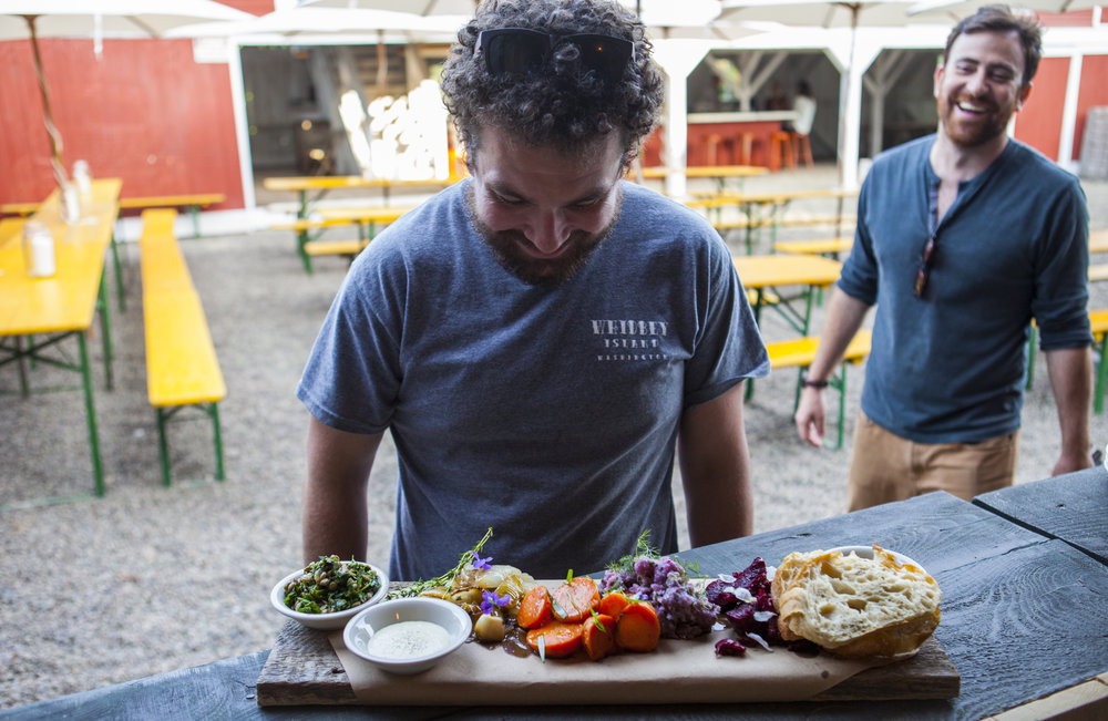 Upstate Eater contributor and Wallabout Hospitality partner Dan Pucci looks over the vegetable board.