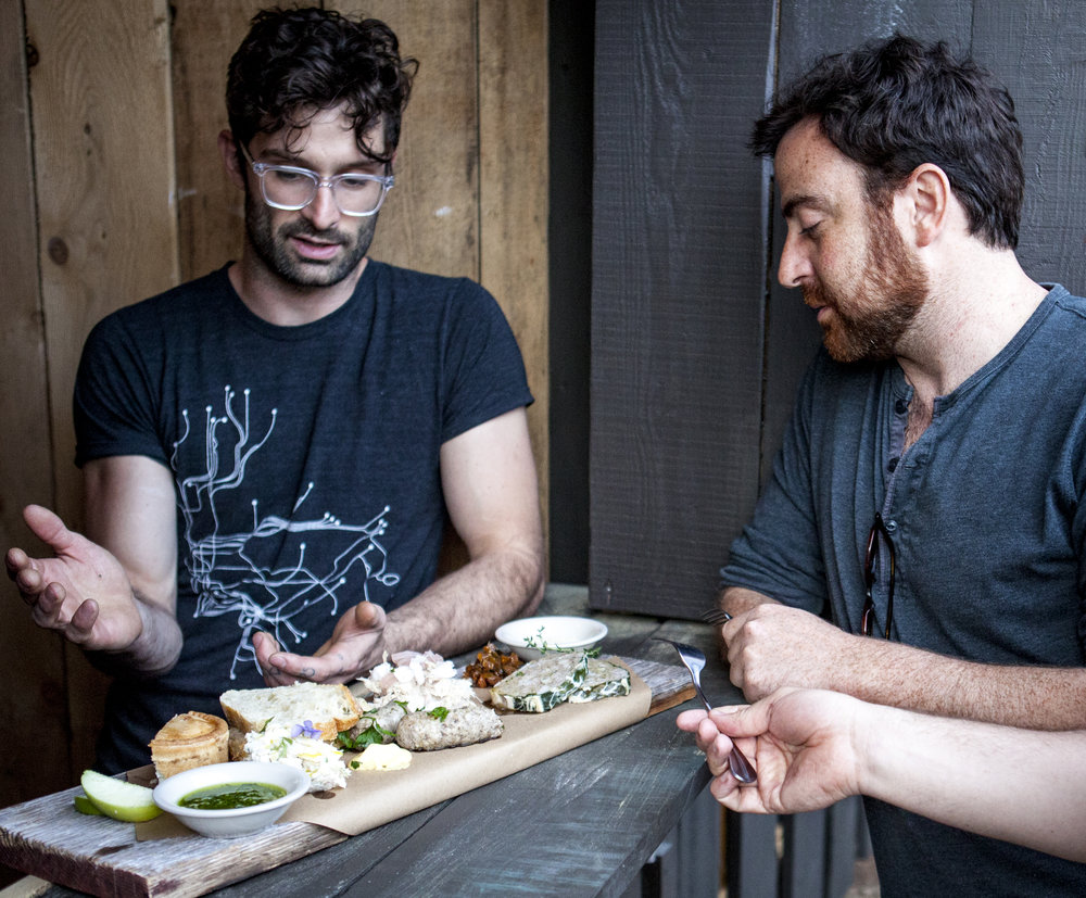 Vinicius Campos and Jonathan Levy, of Wallabout Hospitality, discuss the charcuterie platter at Wayside Cider.