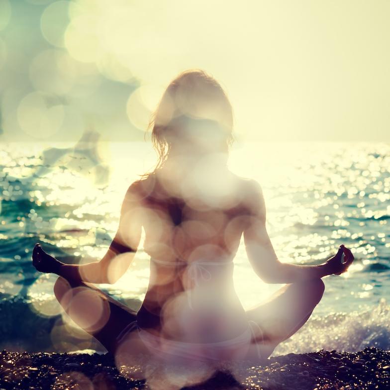 woman_beach_lotus pose copy.jpg