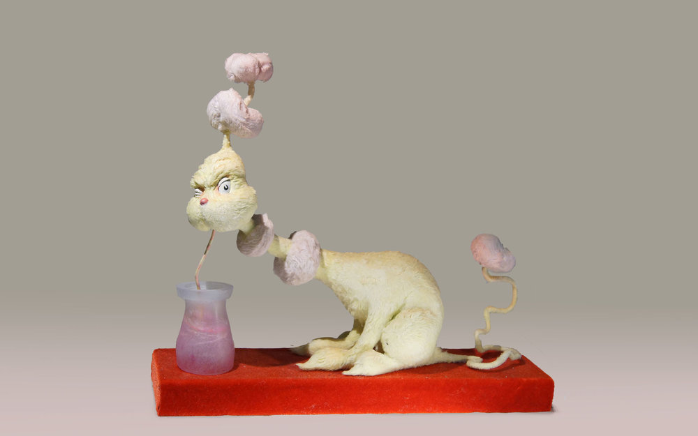 """From the Dr. Seuss book  One Fish Two Fish, this is a sculpture of a  """"Yink"""" who """"Likes to wink and drink pink ink."""""""