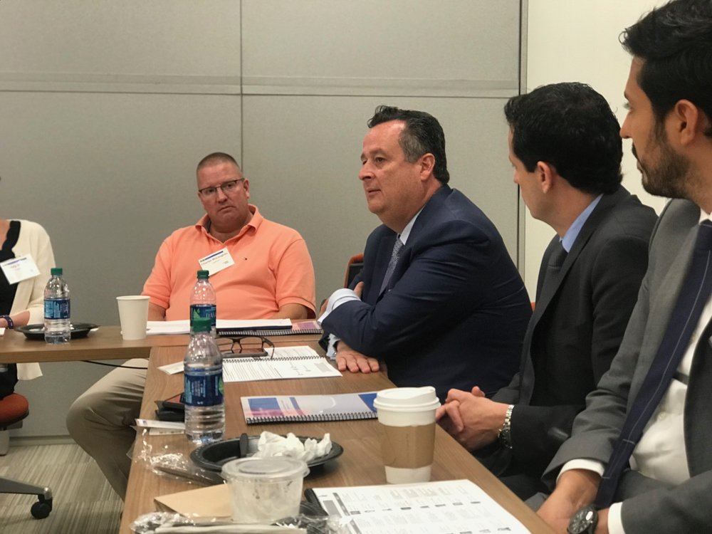 Joe Brusuelas, RSM Chief Economist (center), alerting the audience on the possible negative economic effects of a trade war
