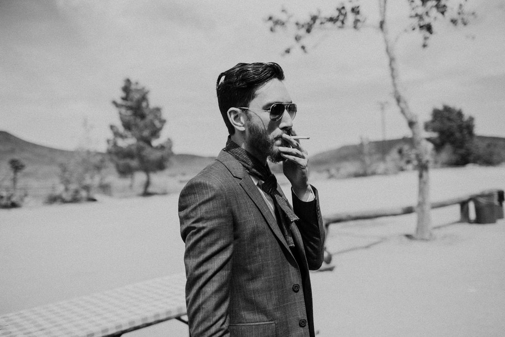 josh having a cigarette before his wedding day