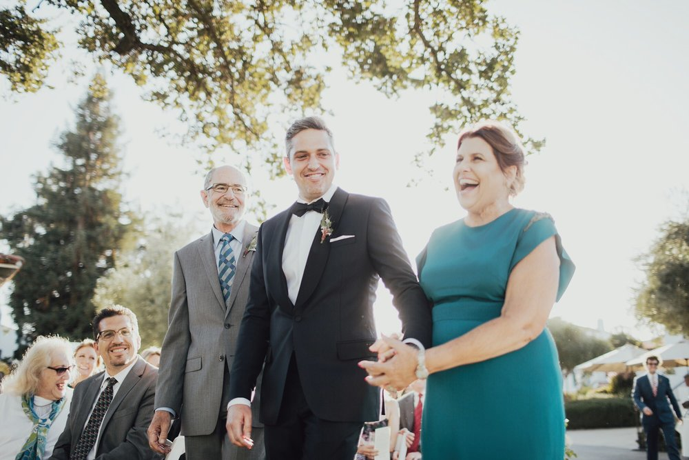 Andy walking his parents down the aisle