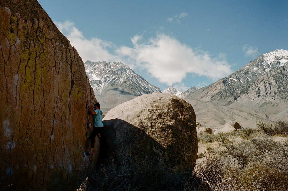Bouldering with the sierras in the background