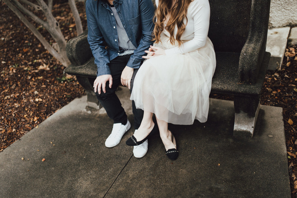 vanessa and ryan sitting on a bench