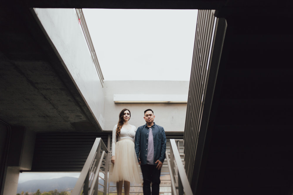 photos in a parking garage of vanessa and ryan