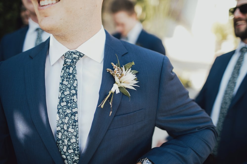 detail photo of the groomsmen's boutonnière