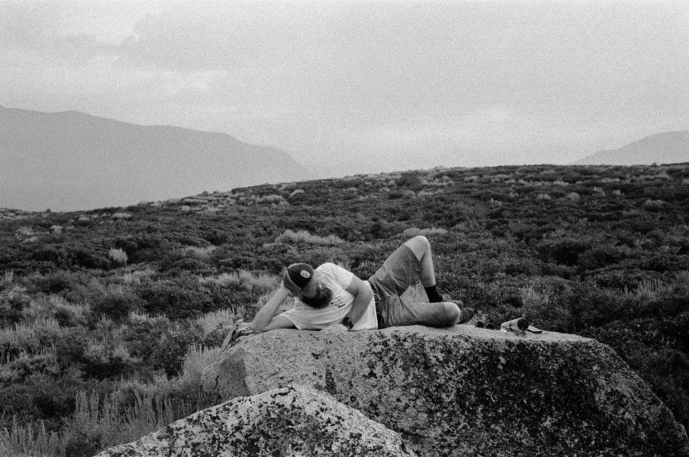 trevor lounging in between bouldering attempts
