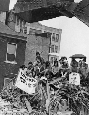 Chinatown 1973, protesters on top of rubble.