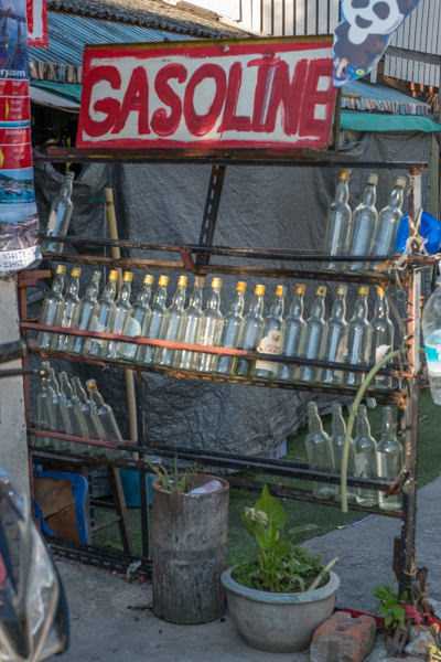 Tell me I'm not the only one who finds this a bit crazy - gasoline in glass bottles, sitting out in the SE Asian sun.