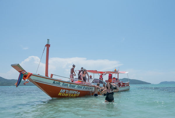 Unloading the boat at Koh Matsum Beach