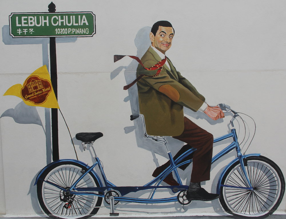 Mr. Bean on a bicycle