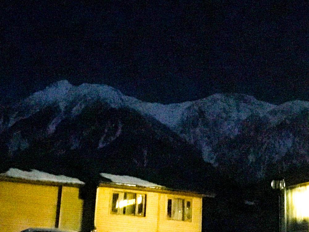 snow-clad peaks at night