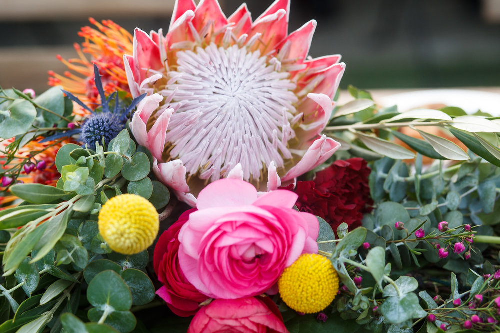 bright and colorful protea bouquet los angeles #lawedding #lrqcfloral