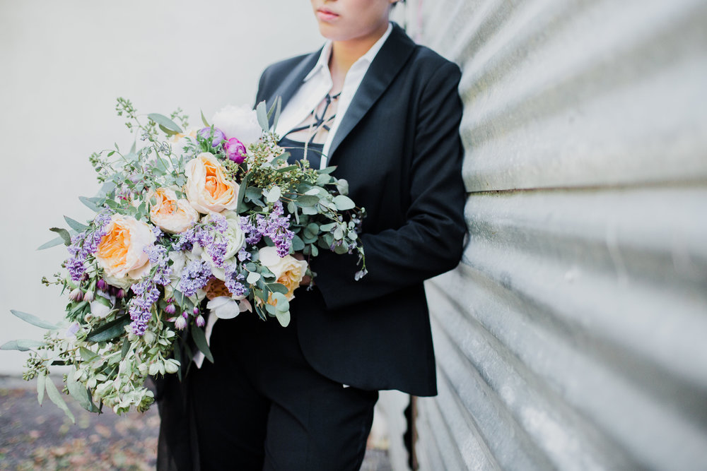 bride in tux with cascading bouquet #lrqcfloral #gaywedding