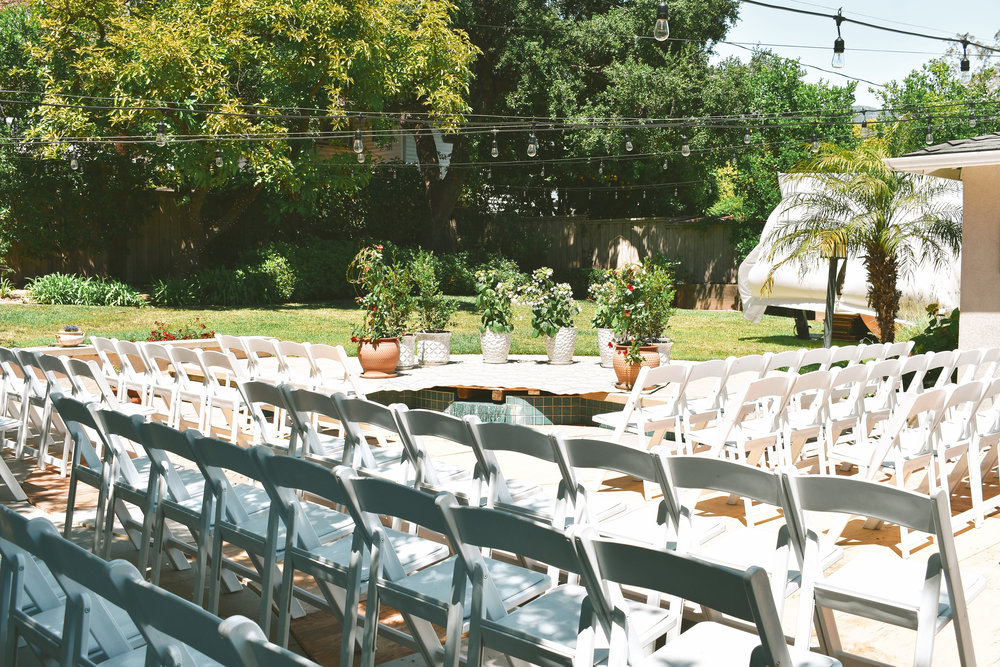 ceremony set up #lrqcfloral #backyardwedding