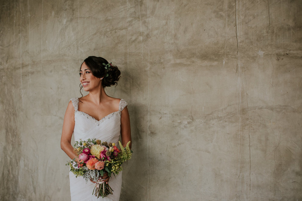 bride with bright bouquet in los angeles ca #lrqcfloral #brightbouquet