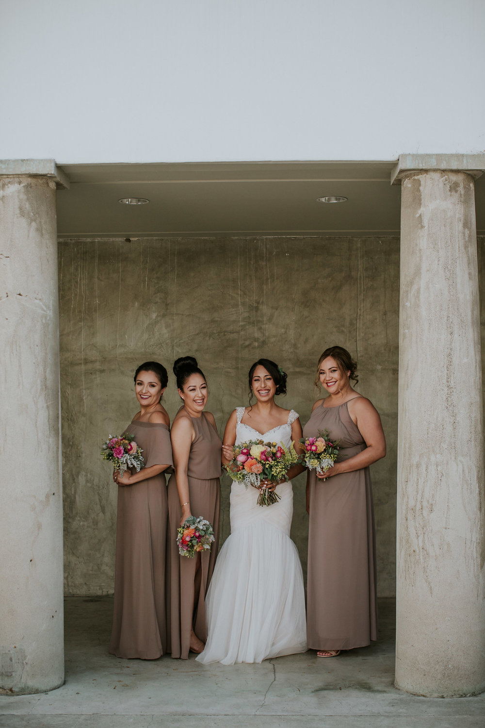 bridesmaids with bright bouquets #lrqcfloral #brightbouquet