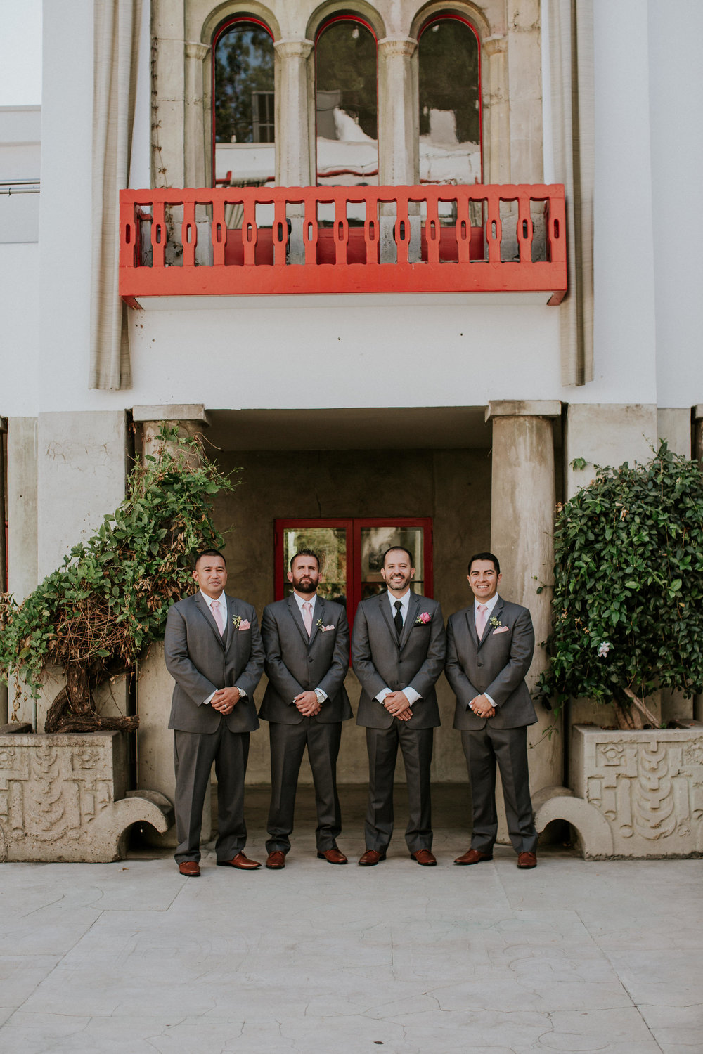 groomsmen with pink bouts at clarke estate in los angeles #lrqcfloral