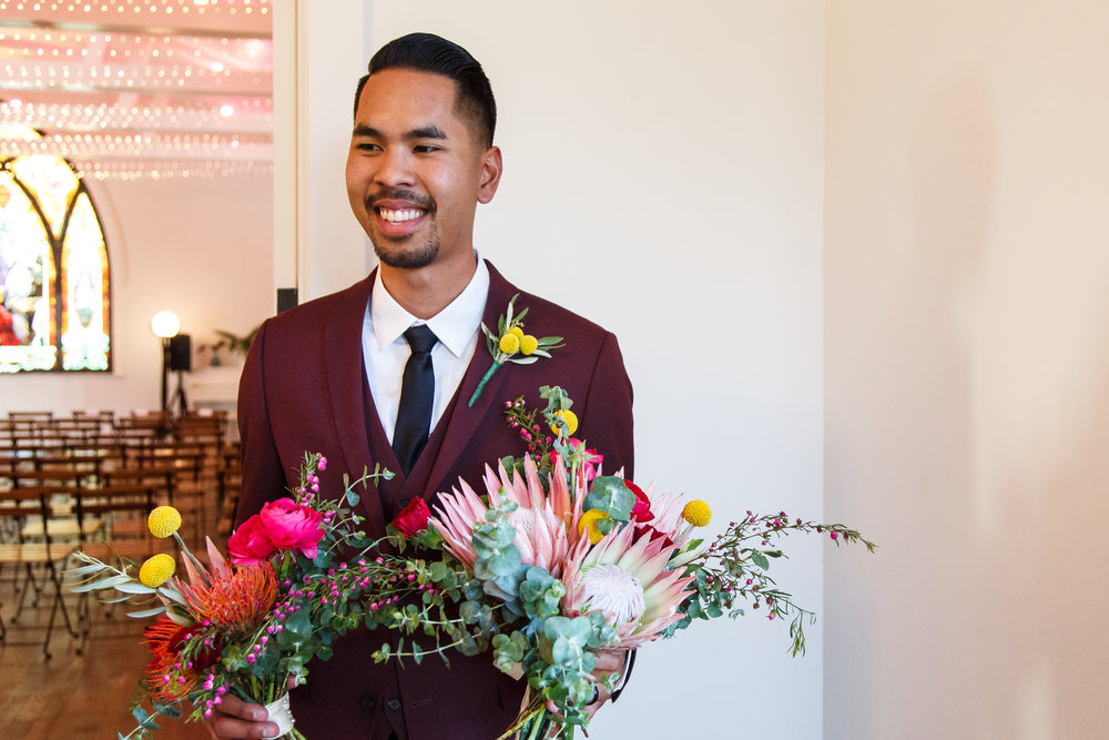 bright and colorful wedding with protea and billy ball #lrqcfloral.jpg