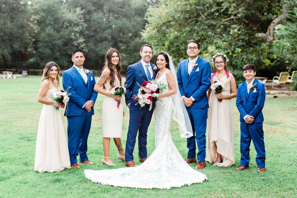 bridal party with bouquets and bouts at calamigos.jpg