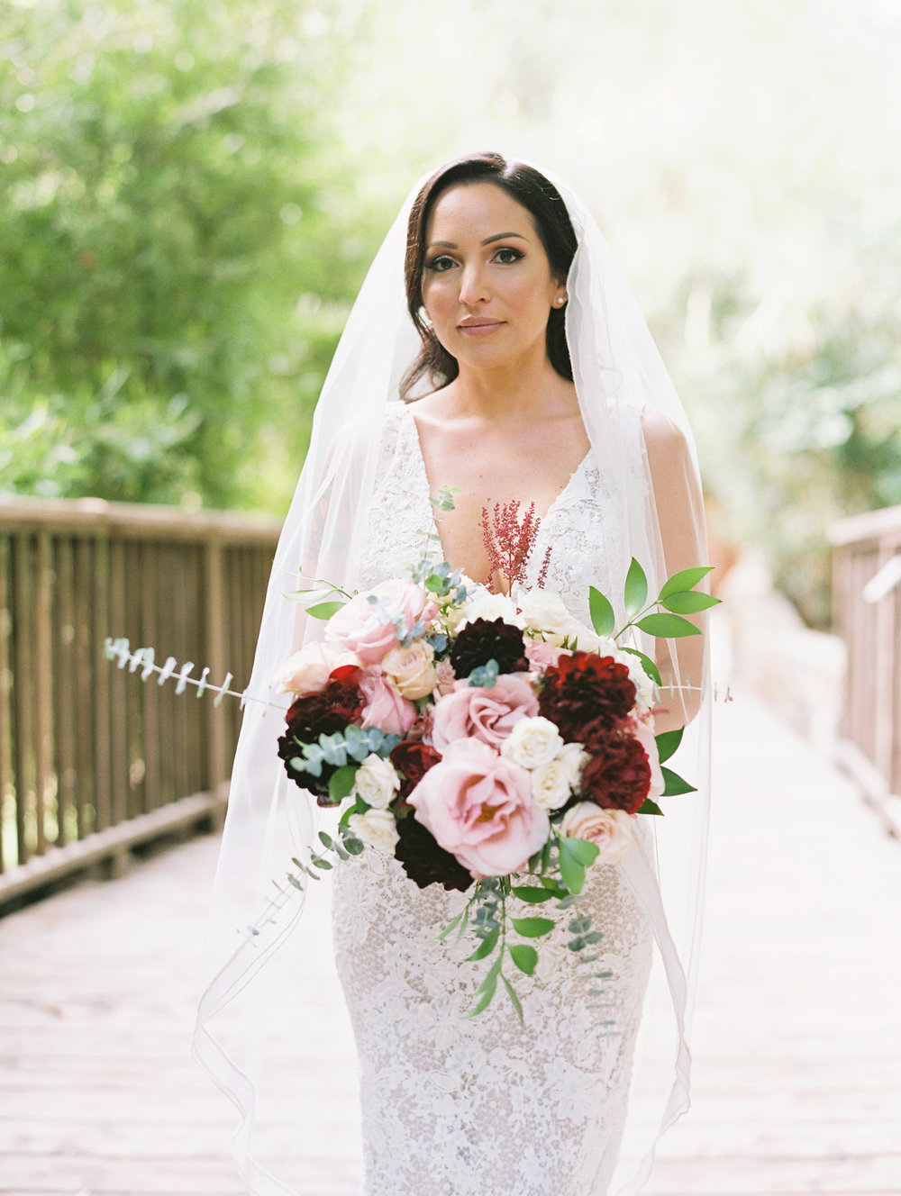 cathedral veil with blush and burgandy bouquet.jpg
