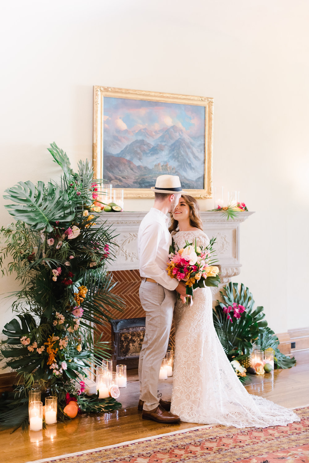 tropical flowers used on a fireplace as a wedding altar.jpg