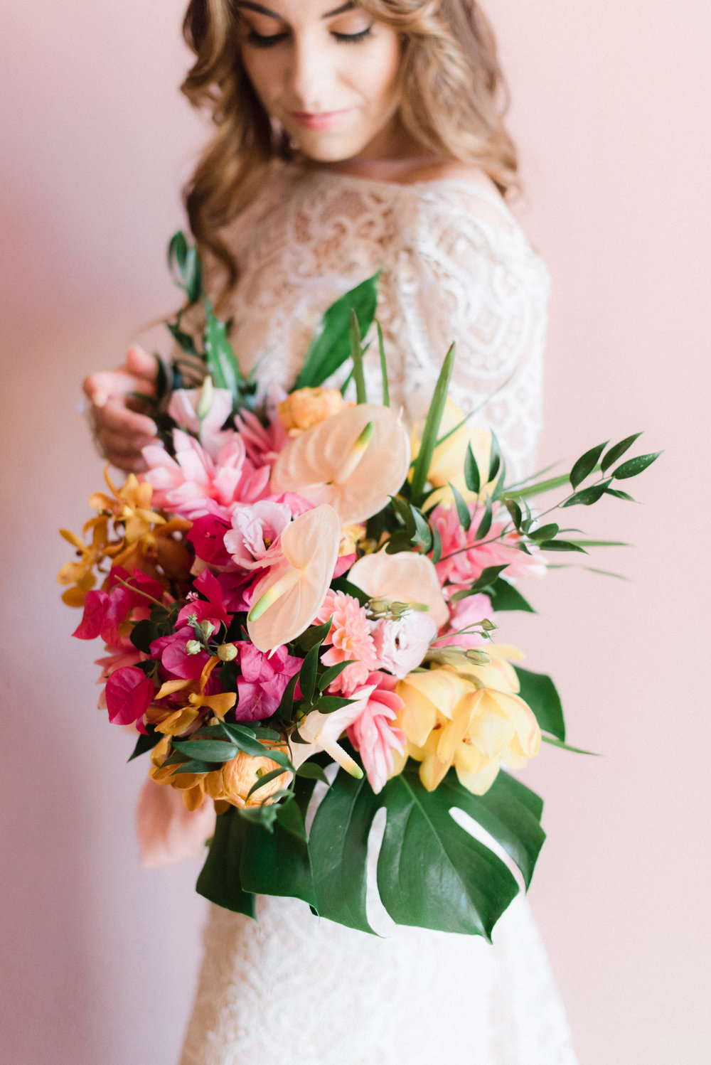 monstera leaves and tropical flowers with bougainvillea for big flowing bouquet.jpg
