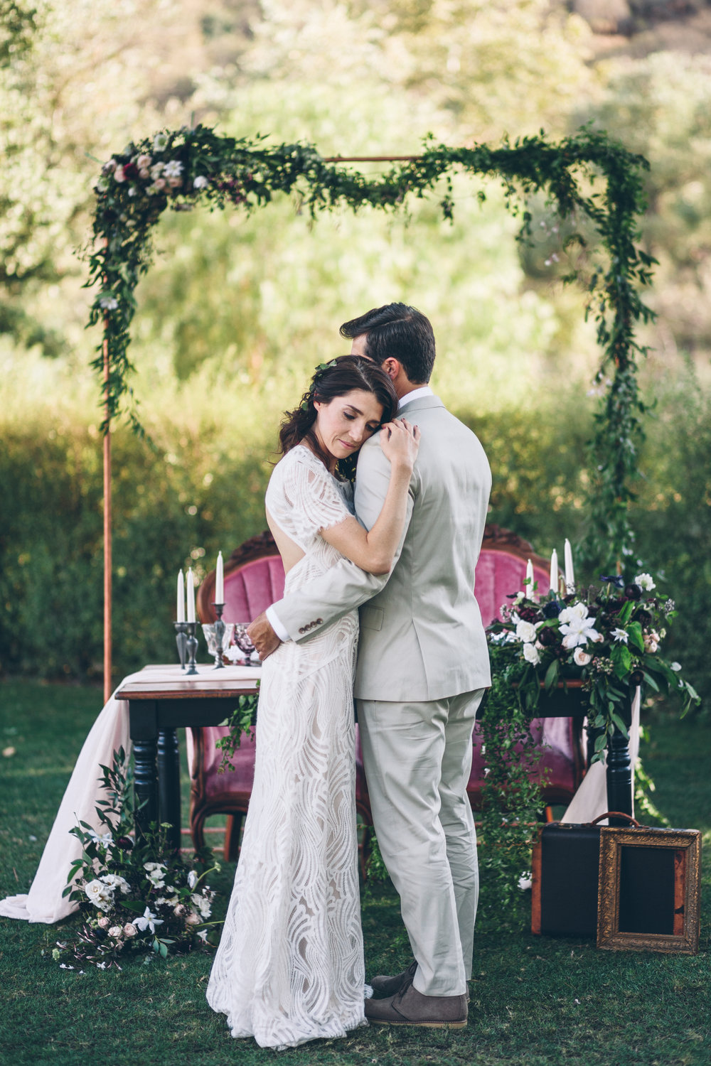 copper arch with hanging jasmine in front of a sweetheart table for a brookview ranch wedding in malibu canyon.jpg