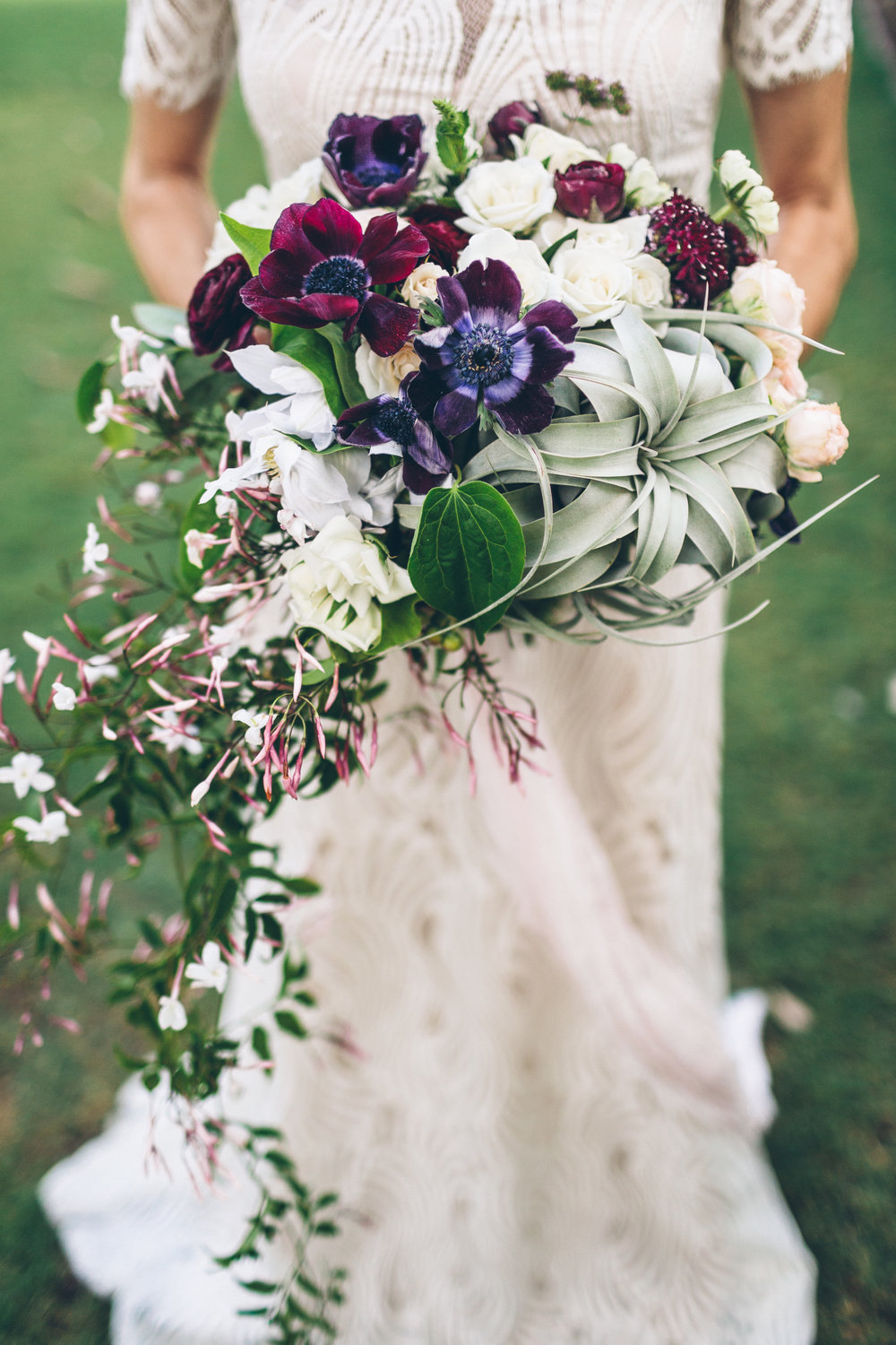 purple, merlot and blush florals in a lush, whimsical, flowy bouquet with an airplant and jasmine for a wedding.jpg