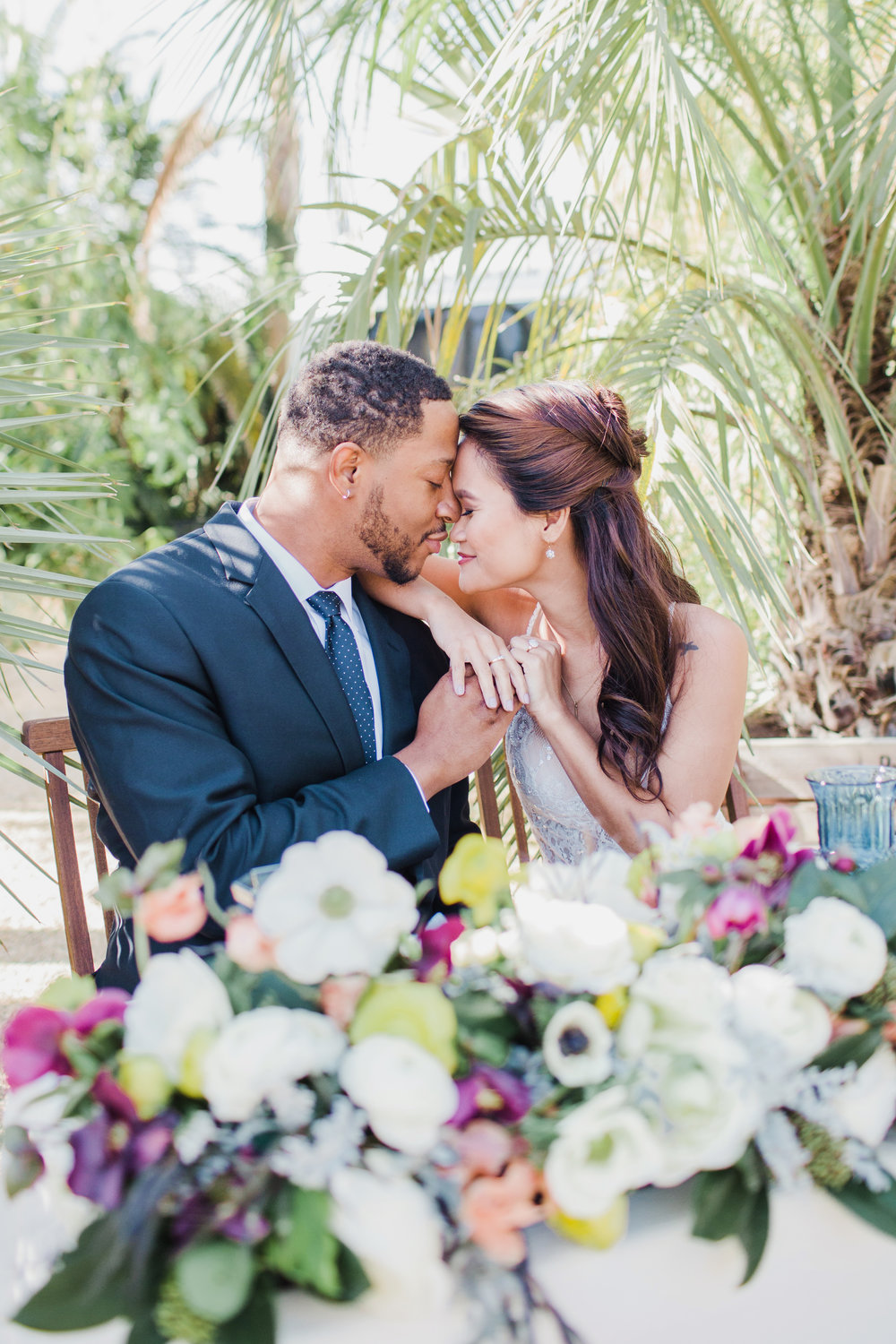 Sweetheart table with purple yellow and white flowers in Santa Barbara.jpg