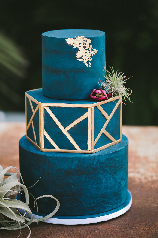 geometric wedding cake with airplants.jpg