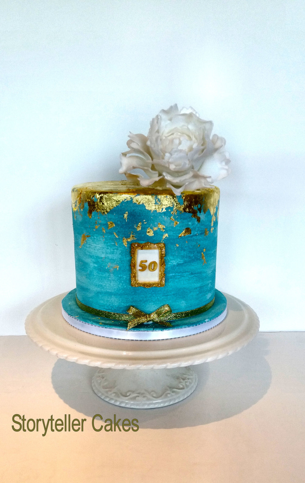 Blue Gold and white 50th birthday cake.jpg